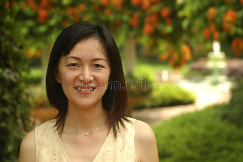 Chinese lady in garden royalty free stock photography
