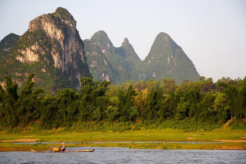 Chinese landscape, Li river, China. Raft fishing on the Li river with karst landscape in the background stock photo