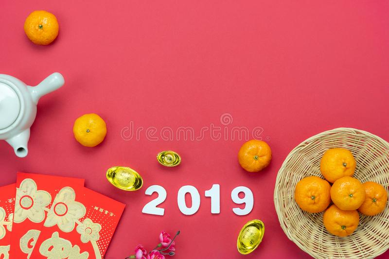 Chinese language mean rich or wealthy and happy.Table top view Lunar New Year & Chinese New Year concept background.Flat lay. Object the orange in basket & red stock photo