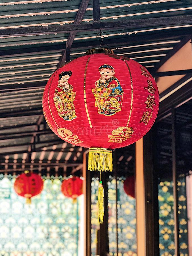 Chinese lantern with boy and girl screened stock images
