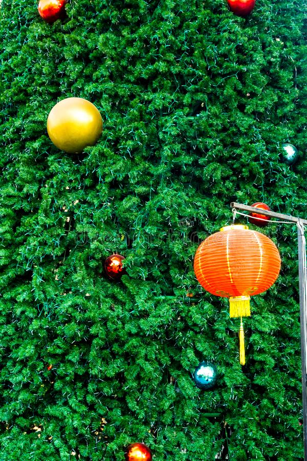 Chinese new year lantern and the Christmas tree with the decoration things royalty free stock images