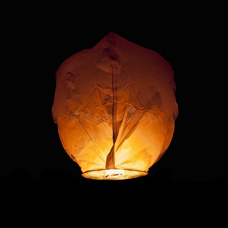 Chinese Lantern. Glowing Chinese Lantern isolated on black royalty free stock photography