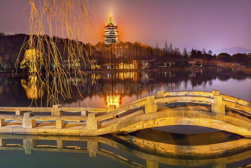 Chinese Leifeng Pagoda Bridge West Lake Hangzhou Zhejiang China. Old Chinese Leifeng Pagoda Bridge Garden West Lake Hangzhou Reflection Zhejiang China stock image