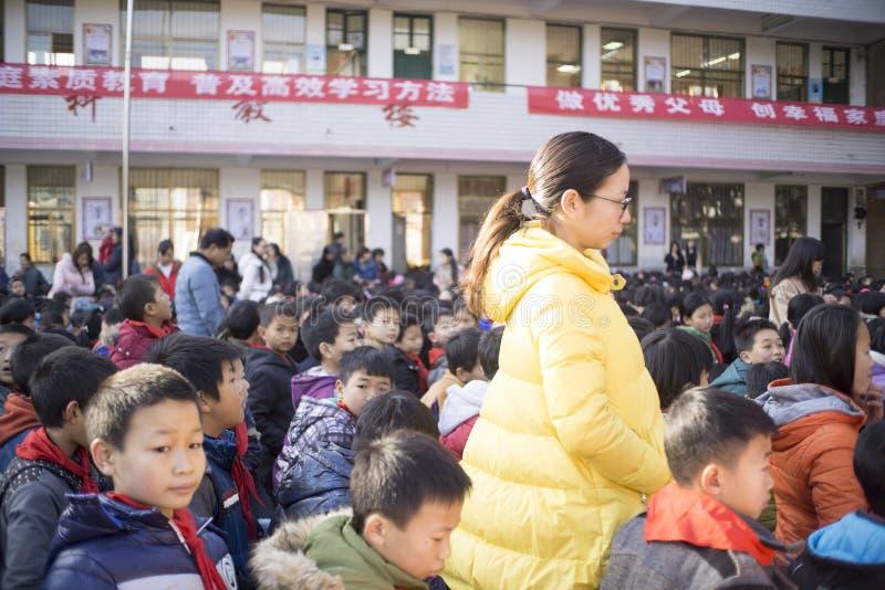 Chinese leraar wanneer de studenten listenning stock afbeelding
