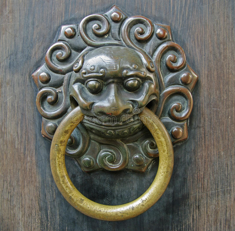 Chinese lion doorhandle royalty free stock photo
