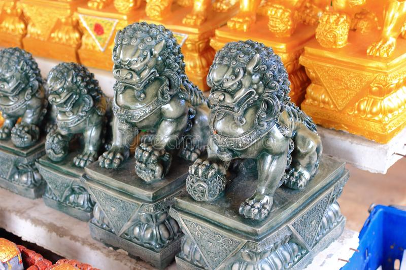 Chinese lion statue. The image of the Chinese lion statue are selling at local market royalty free stock photo