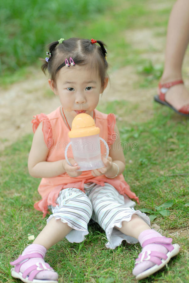 Download Chinese lovely little girl stock image. Image of outdoor - 12213053