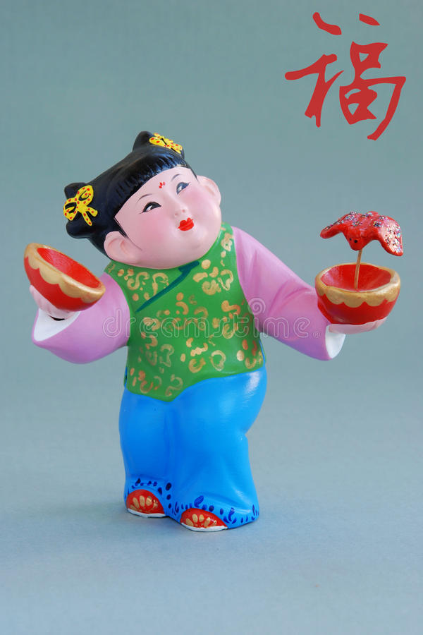 Chinese lucky clay figurine-great happiness(char) royalty free stock image
