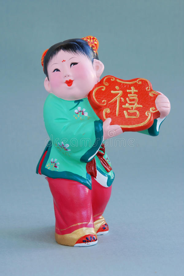 Chinese lucky clay figurine_lucky stock photo
