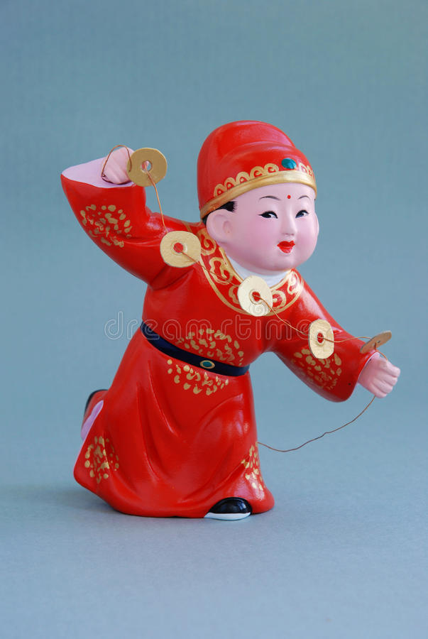 Chinese lucky clay figurine - Rich stock photo
