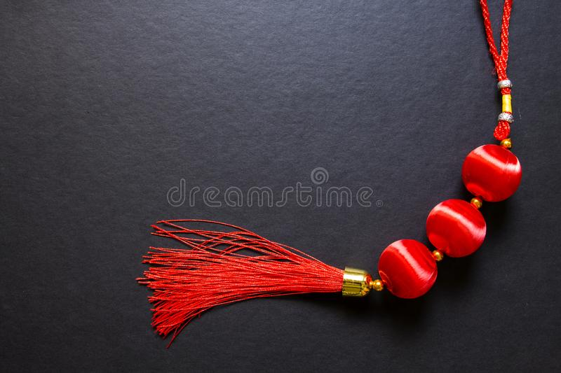 Chinese Lucky knot on black background. Chinese New Year decor top view photo. royalty free stock images