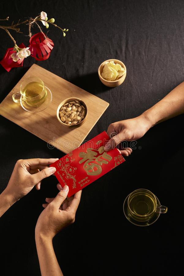 "Chinese Lunar New Year concept red envelope with Chinese character means happiness or good fortune, the chinese sentence means "" stock photography"