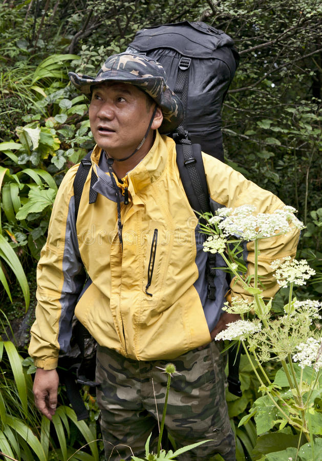 Download Chinese Man Backpacking Through Jungle Stock Photo - Image: 20868230