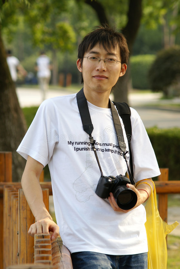 Chinese man with camera stock photo