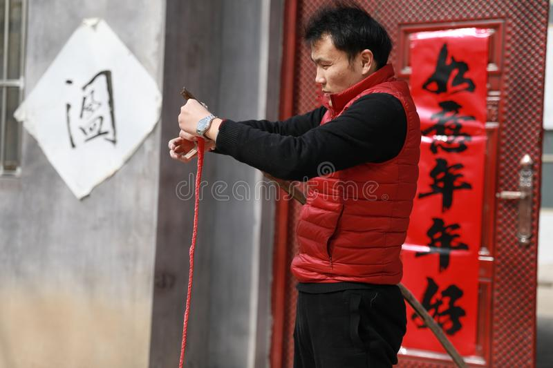 Chinese man Firecrackers on New Year`s Day royalty free stock photography