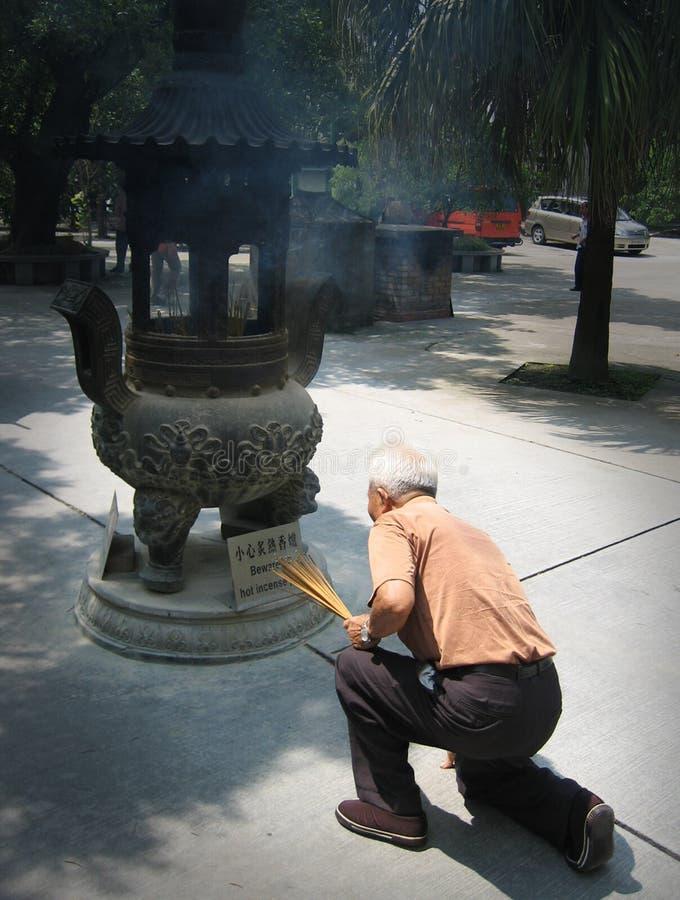 Chinese man lighting insence royalty free stock photos