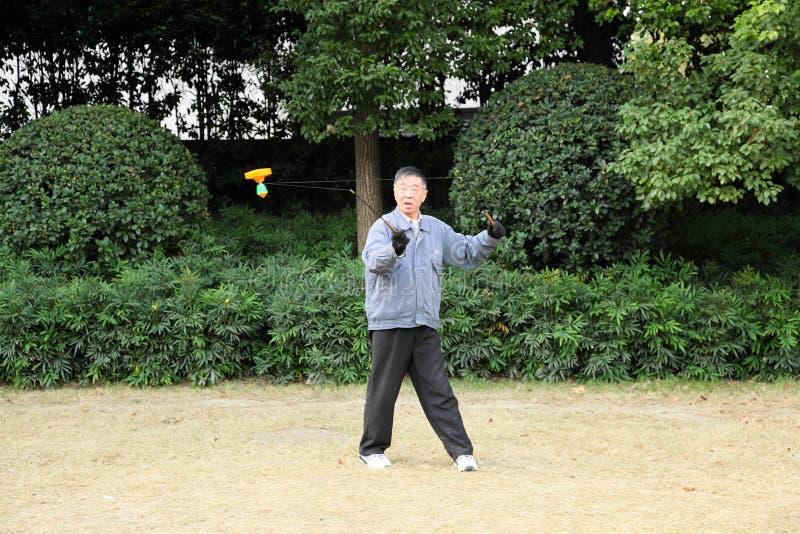 Chinese man playing Yo Yo game