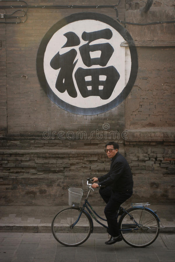 Download Chinese man riding a bike editorial image. Image of symbol - 15390725