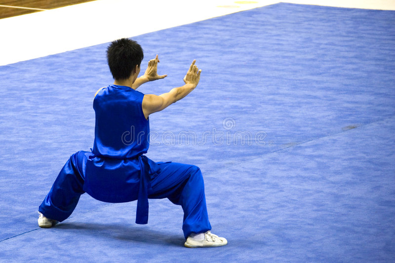 Chinese Martial Arts (Wushu). Chinese martial arts exponent in a Wushu competition stock photos