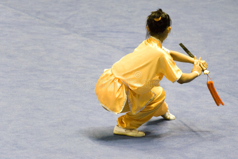 Chinese Martial Arts (Wushu). Chinese martial arts exponent in a Wushu competition stock images
