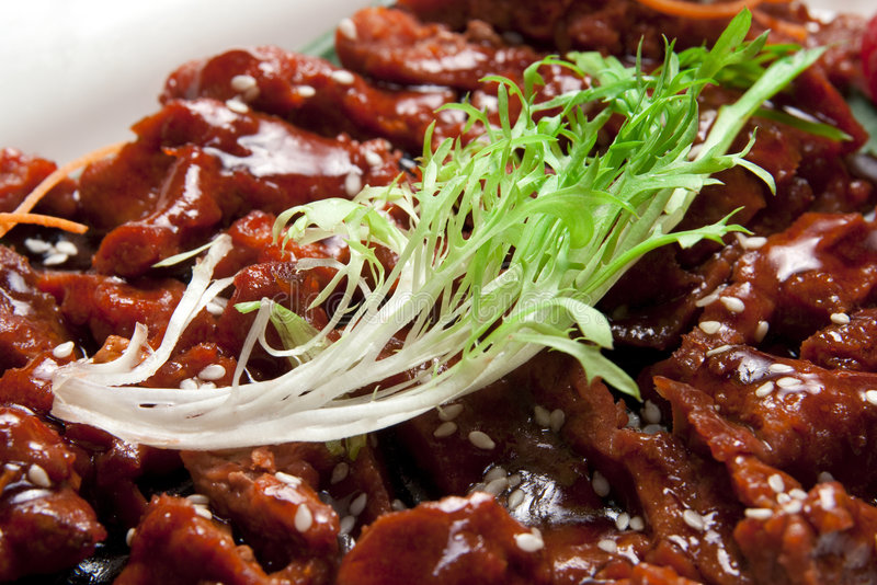 Chinese meat stir fried in wok stock images