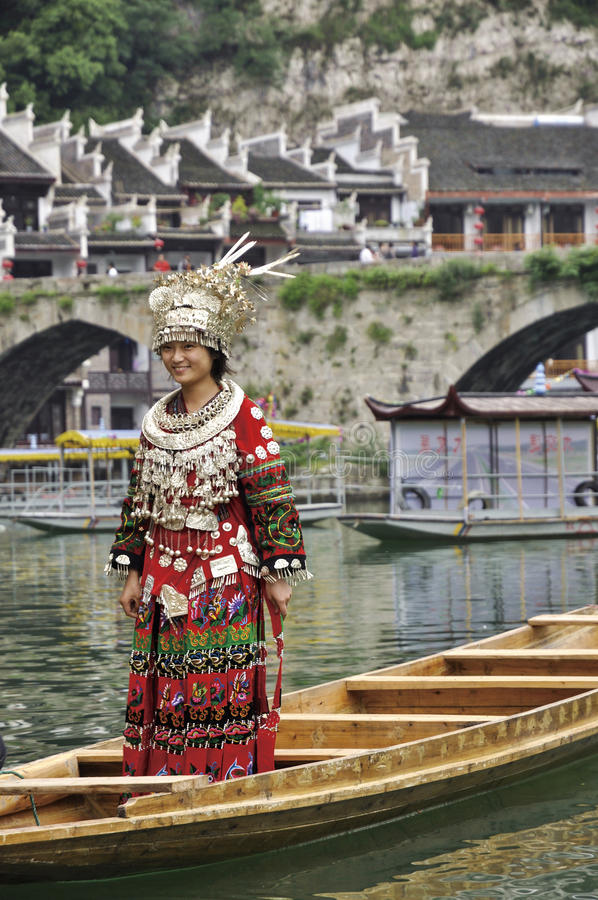 The chinese miao girl. A Miao girl was displaying Miao's traditional cloth with silver headdresses and ornaments in Zhenyuan ,Guizhou,China stock images