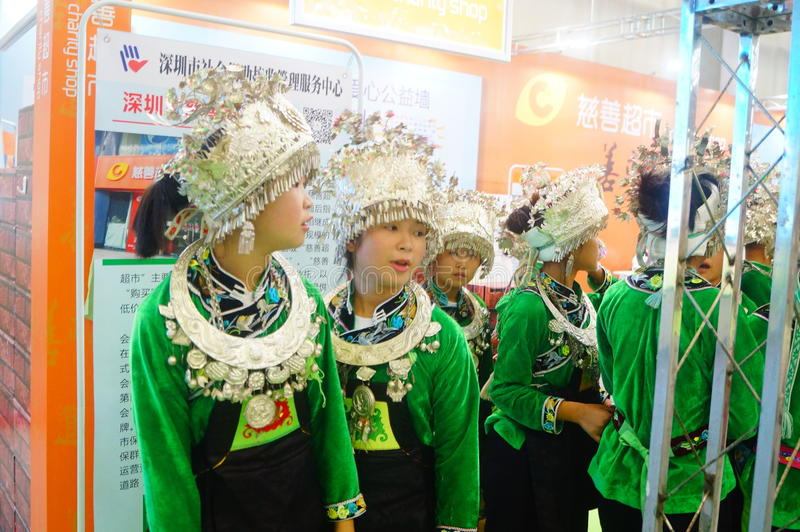 Chinese Miao girls. Chinese Miao and girls, in the Fifth China charity project exchange exhibition event site, Shenzhen Convention and Exhibition center stock photography