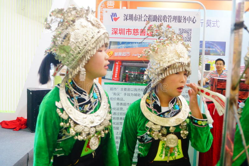 Chinese Miao girls. Chinese Miao and girls, in the Fifth China charity project exchange exhibition event site, Shenzhen Convention and Exhibition center royalty free stock photo