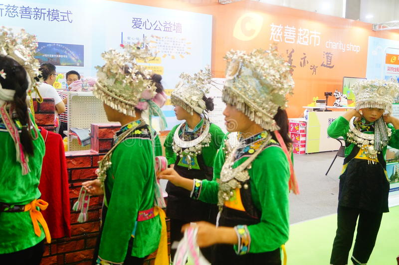 Chinese Miao girls. Chinese Miao and girls, in the Fifth China charity project exchange exhibition event site, Shenzhen Convention and Exhibition center stock images