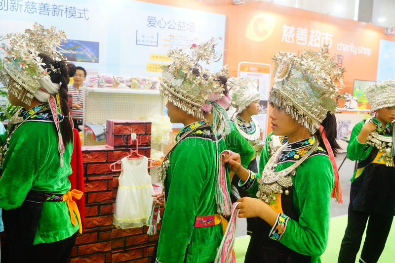 Chinese Miao girls. Chinese Miao and girls, in the Fifth China charity project exchange exhibition event site, Shenzhen Convention and Exhibition center royalty free stock image