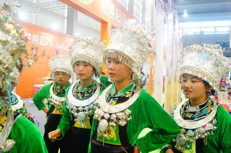 Chinese Miao girls. Chinese Miao and girls, in the Fifth China charity project exchange exhibition event site, Shenzhen Convention and Exhibition center stock image