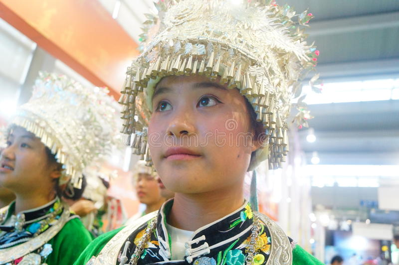 Chinese Miao girls. Chinese Miao and girls, in the Fifth China charity project exchange exhibition event site, Shenzhen Convention and Exhibition center royalty free stock images