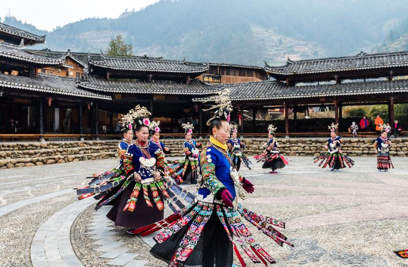 The Chinese miao women wearing traditional clothes and dancing in open opera house of Xijiang Qianhu Miao Village The One stock images