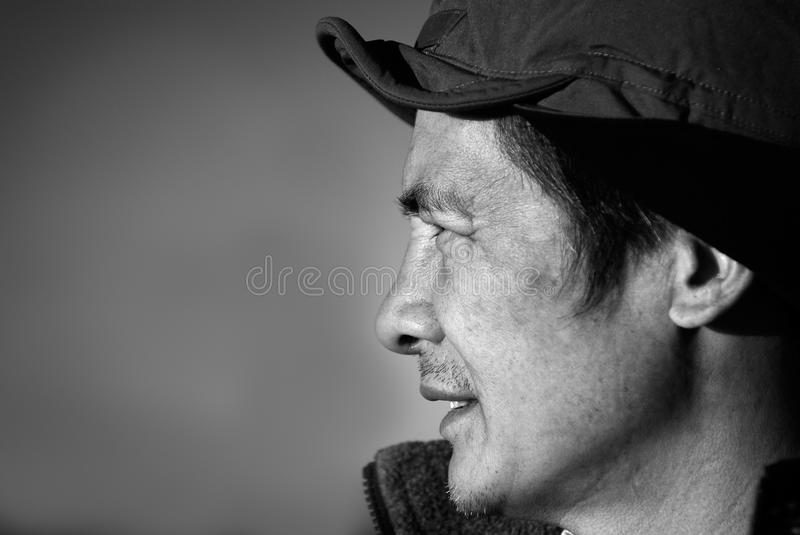 Chinese middle-aged person in the outdoor royalty free stock photo