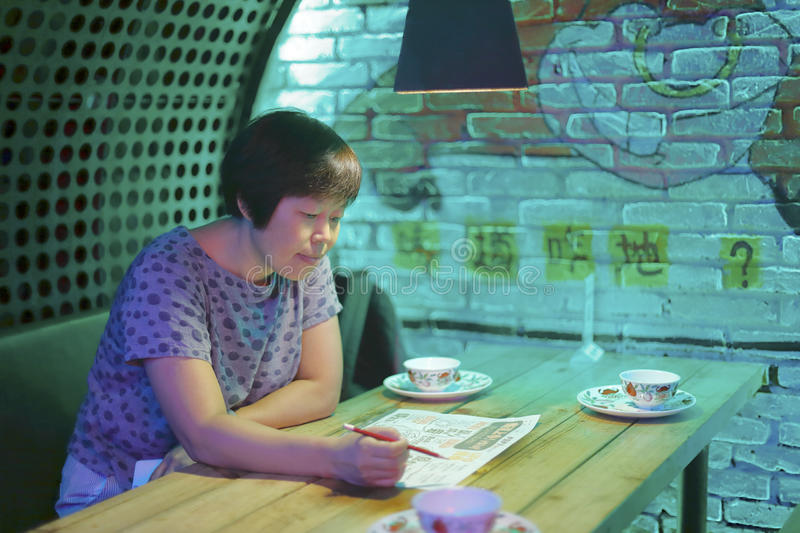 Chinese middle-aged woman order dishes stock photo