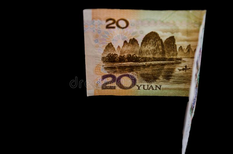 Chinese money on a black background. Yuan close up. 20 yuan. Chinese money on a black background. Yuan close up royalty free stock photo