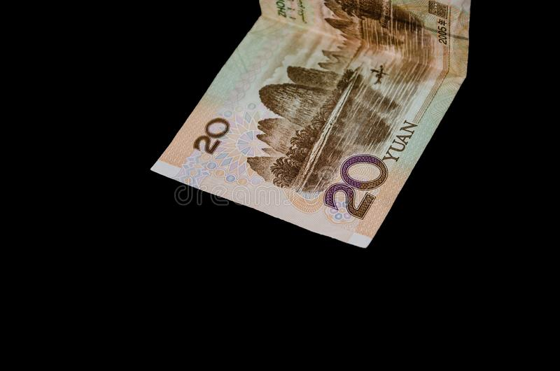 Chinese money on a black background. Yuan close up. 20 yuan. Chinese money on a black background. Yuan close up royalty free stock photos
