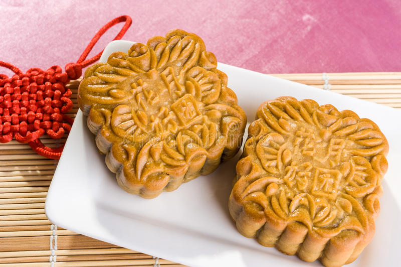Chinese mooncakes with text meaning good luck and prosperity royalty free stock photo
