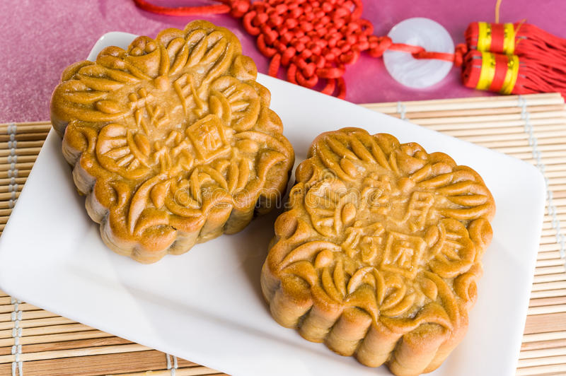 Chinese mooncakes with text meaning good luck and prosperity stock photos