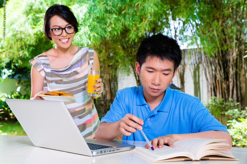 Chinese mother and Asian Son at home stock photo