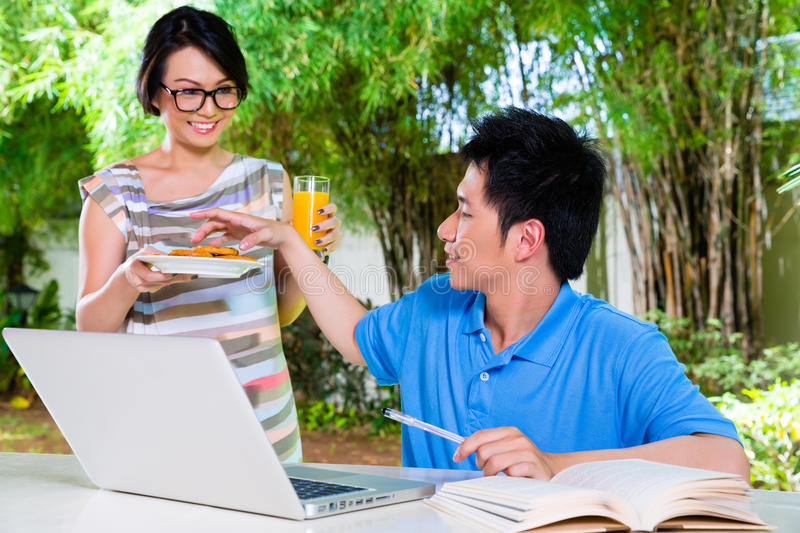 Chinese mother and Asian Son at home stock photos