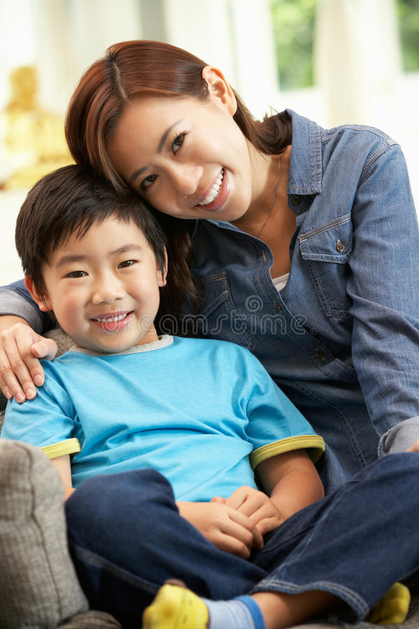 Download Chinese Mother And Son Sitting On Sofa Stock Photo - Image of chinese, asian: 26244806