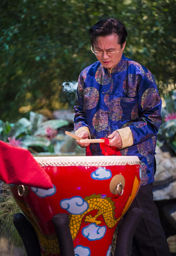 Chinese musician. LAS VEGAS - FEB 11: Chinese musician perform during the Chinese New Year celebrations at the Bellagio Hotel Conservatory & Botanical Gardens on royalty free stock photography