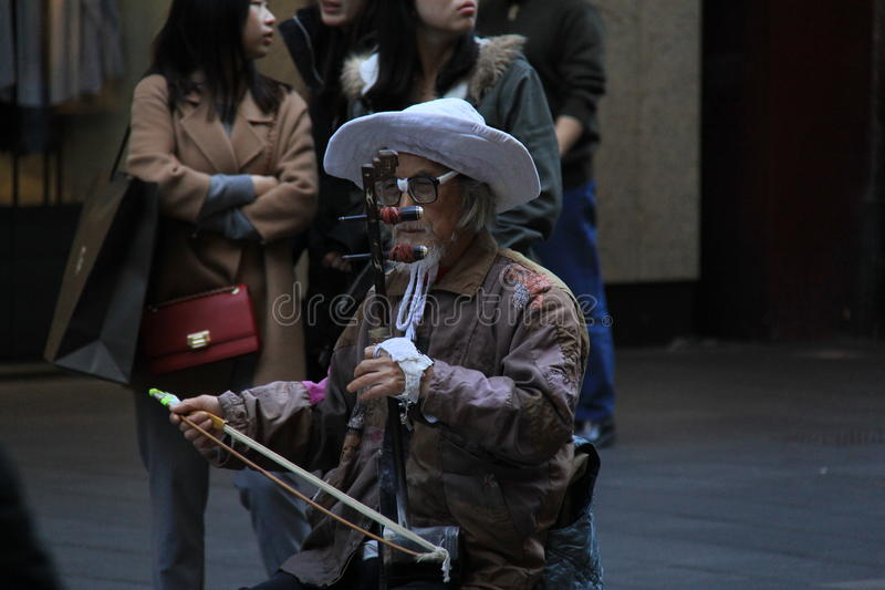 Chinese Musician in Sydney. Old musician plays traditional chinese musical instrument called Erhu or Nanhu, a two-stringed bowed instrument like chinese Violin royalty free stock photos