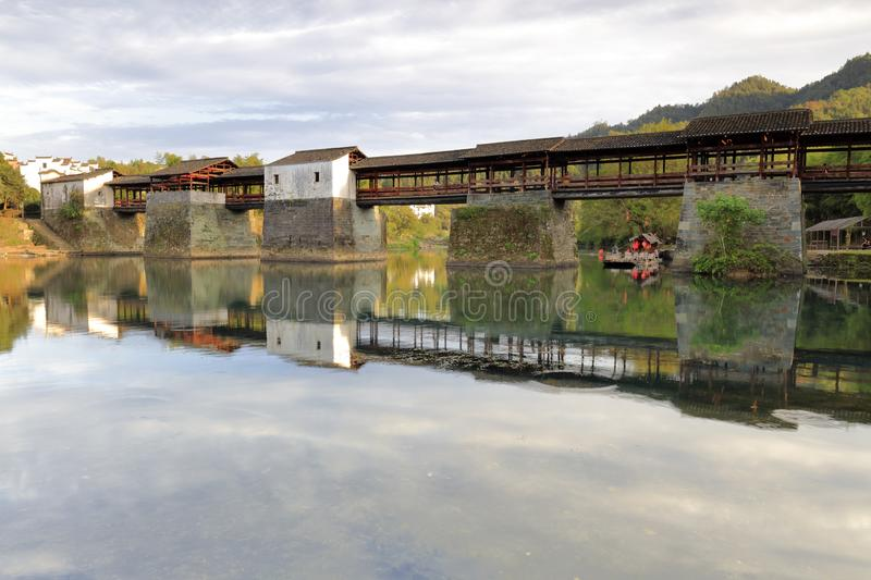 Chinese song dynasty caihongqiao covered bridge in wuyuan county, adobe rgb. During the chinese national day of 2018, tourist visit caihongqiao covered bridge in royalty free stock photography