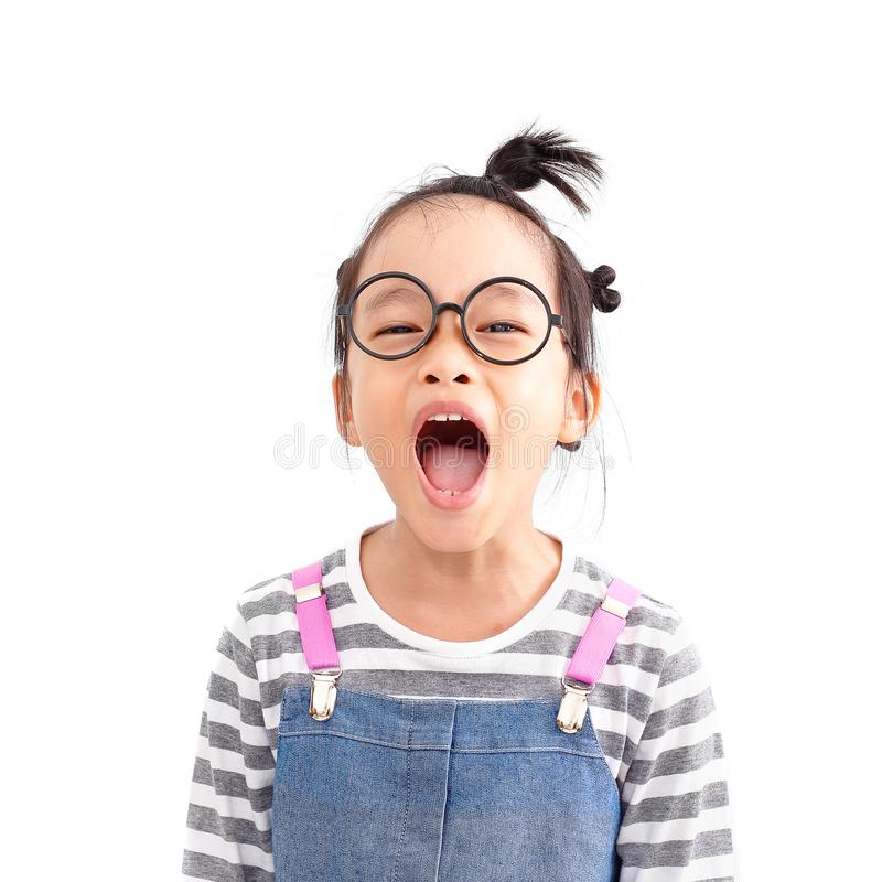 Child voice so lound. Chinese naughty girl shouting loud with topknot hair style isolated on white background royalty free stock photo