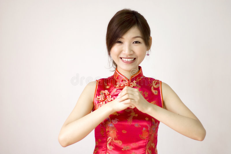 Chinese new year. Oriental girl wishing you a happy chinese new year royalty free stock photo