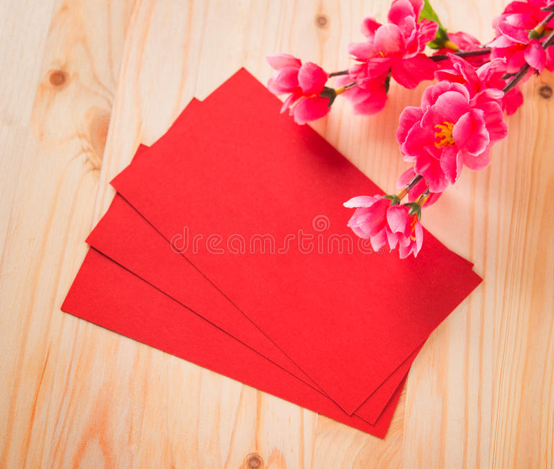 Chinese new year and ang pow. Chinese new year festival decorations, blank red packet or ang pow ready for text stock photography