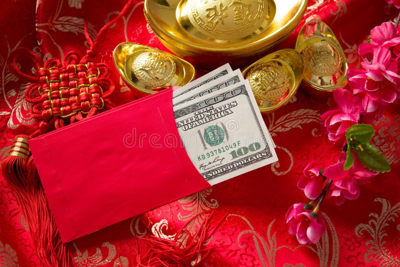 Chinese new year ang pow with dollars inside. Chinese new year festival decorations, ang pow is given to children and elders during chinese new year for blessing stock photo