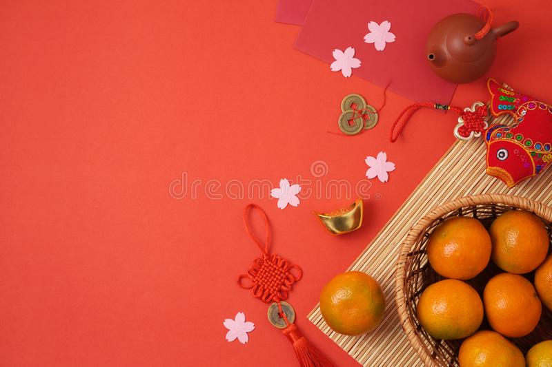 Chinese New Year background with traditional decorations for Spring festival on red table. Top view from above. Chinese text: fortune, good luck and wealth royalty free stock images